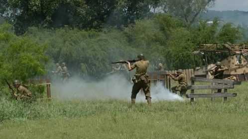 Action shot of me in the middle of a WWII re-enactment in May 2012.