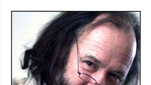 long hair and beard headshot