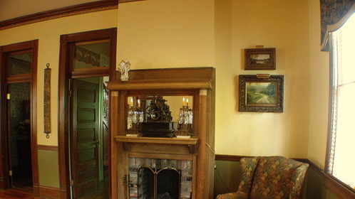 Large gathering room original cypress fireplace