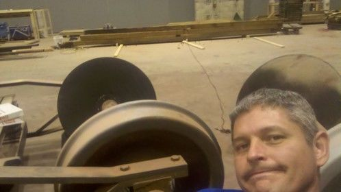 THE LONE RANGER MOVE SOUND STAGE - At Silver Bullet Productions  Albuquerque, NM Long night, upon arrival and assembling custom communications  solution for next day deployment on set.... wheels from train in background.  They are made of wood believe it or not.