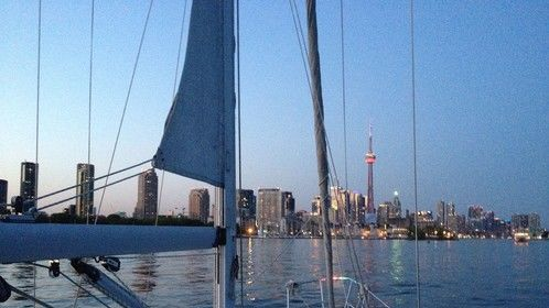 "The sun setting over my hometown, Toronto, as seen on board my sailboat, ""Daydreamer""."