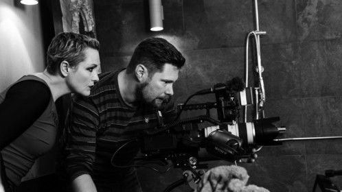 "Regina Lund with photographer Samir Dounas on the set of ""LISTEN""."