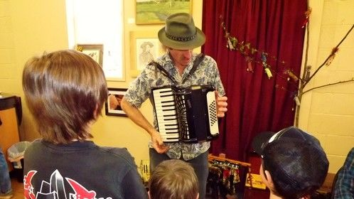 A local guy named Val playing accordion at our recent art show.  :^)