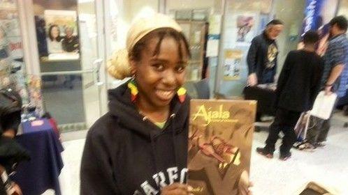 Fan with My Ajala Comic... Written & Created by Robert Garrett & N Steven Harris