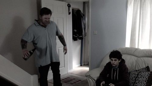 Paul and his drunken father in a scene from TEENAGE KICKS