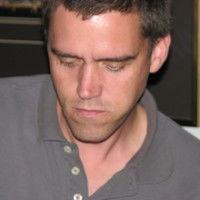 J Tom Field